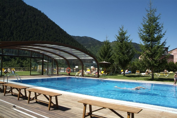 Outdoor covered and heated swimming pool